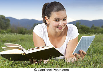 Cute girl in big dilemma: traditional book or modern...