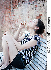 Beautiful young woman smoking