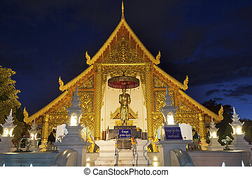 Wat Phra Singh temple at night in Chiang Mai, Thailand