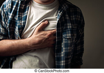 Heartache - Young adult man suffering from severe heartache.