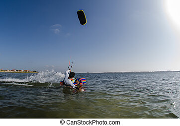 Kite Surfer - Kiteboarder enjoy surfing on a sunny day