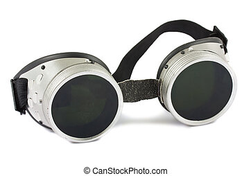 Old used welding goggles isolated on white background