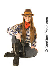 Sitting cowgirl 2 - Young woman wearing cowboy clothes...