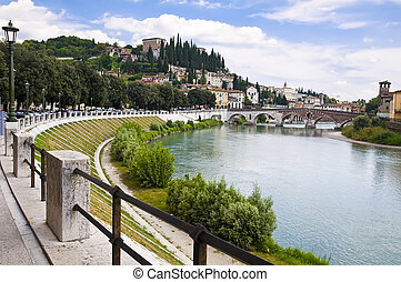 Adige River Embankment in Verona, Italy - Summer view of the...