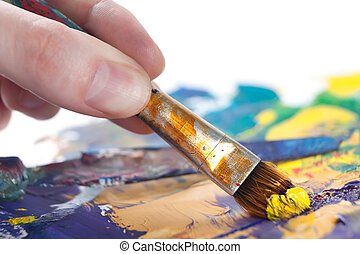 Somebody is painting something with paintbrush - Somebody is...