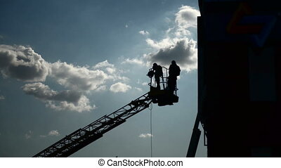 Workers on a tower