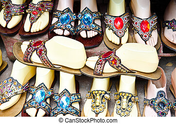 Colorful shoes - Shoes adorned with colorful stones.