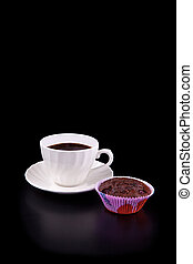 Hot cup of coffee and chocolate cherry muffin on black
