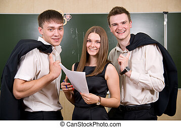 Three young succeeding the businessman against a board