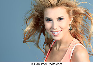 hair care - Portrait of a smiling young woman with beautiful...