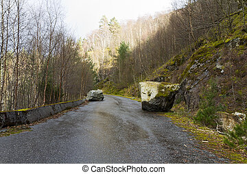 run-down road in rural landscape - unused, run-down road in...