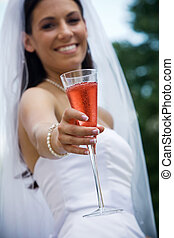 Bride with a cocktail - Wedding bride holding her crink in a...