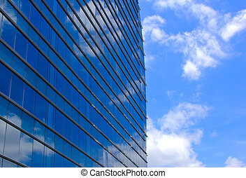 Modern office building and blue sky reflection