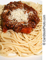 Spaghetti bolognese with parmesan vertical