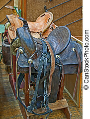 Two Retro Leather Horse Saddles - This veritcal image...
