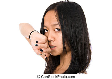 The beautiful Vietnamese girl with hands at a cheek