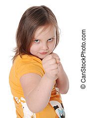 Emotional girl in a pose of the boxer isolated on white...