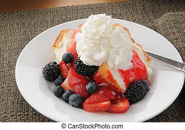 Gourmet dessert with berries and angle food cake - A plate...