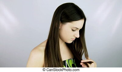 nice girl cutting split ends hair
