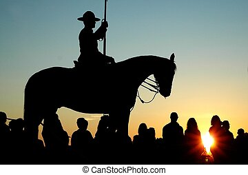 RCMP sunset - A mounted RCMP officer stands guard as the...