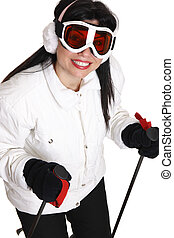 Female skier in white parka, black ski pants wearing ear...