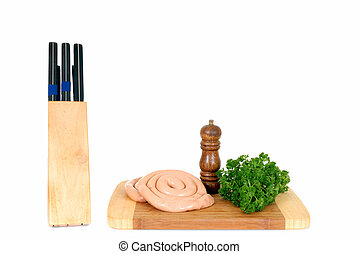 chipolata on cutting board - chipolata sausage on cutting...