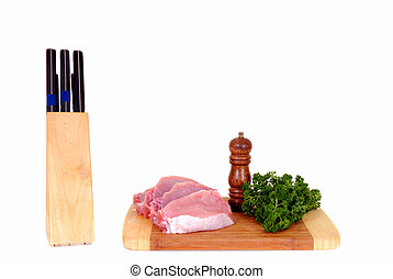 Tenderloin meat on cutting board
