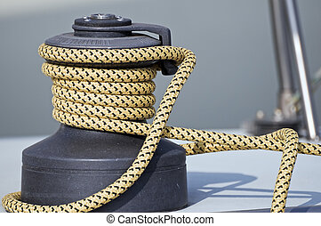 Winch - Rope rolled up on a winch in a sailboat