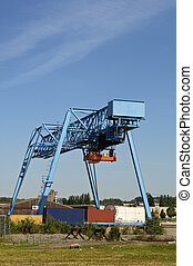 Industrial crane with flat containers
