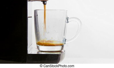 coffee maker pours coffee into a cup. close-up