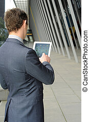 Business man on his ipad