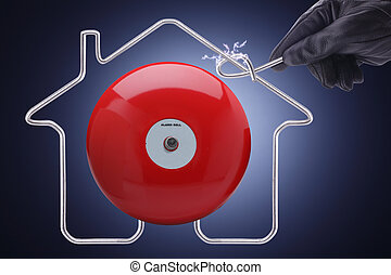 home alarm system - alarm bell surrounded by wire
