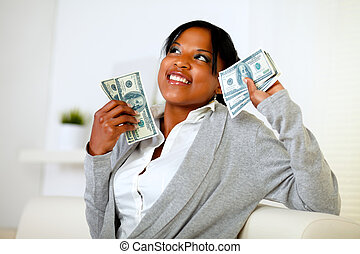 Charming woman holding plenty of cash money - Portrait of a...