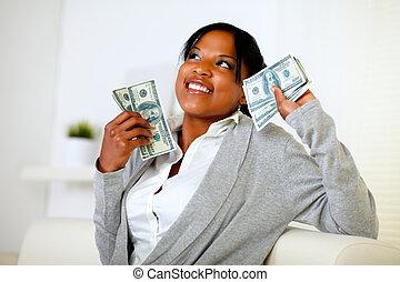 Charming woman holding plenty of cash money - Portrait of a...