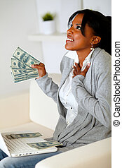 Happy woman holding plenty of cash money - Portrait of a...