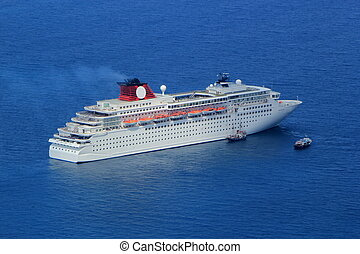 Cruise ship - Big cruise ship and two small boats on the...