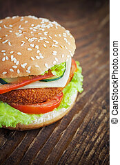 Fried chicken or fish burger sandwich - Junk food concept....