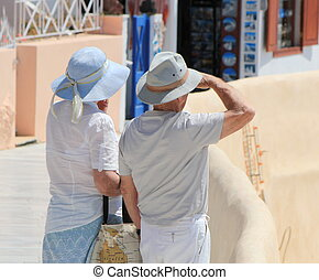 Couple of tourists, Oia, Santorini, Greece