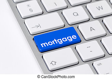 Keyboard with one blue button with the word mortgage - Photo...