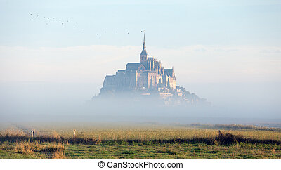 mystic castle in the clouds - Mont Saint Michel in the...