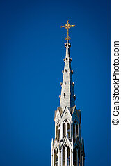 Golden Crucifix Atop Tall Church Steeple - Bell tower...