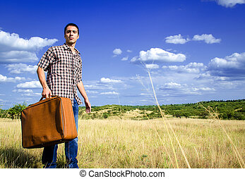 Young traveler in middle of nowhere - Young traveler with...