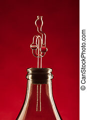 fermentation tube and demijohn on red background