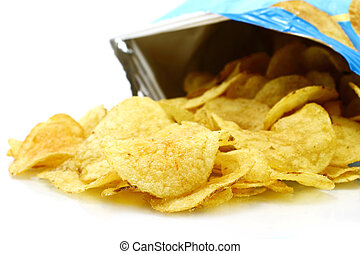 Potato chips poured out from packing on a white background