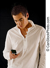 Message - Young man using his mobile phone and sending...