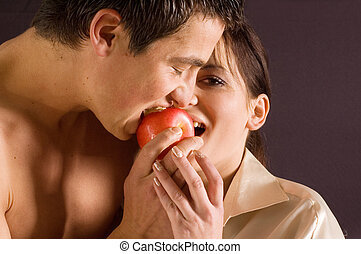 Couple eating a apple - Young happy and beautiful couple...