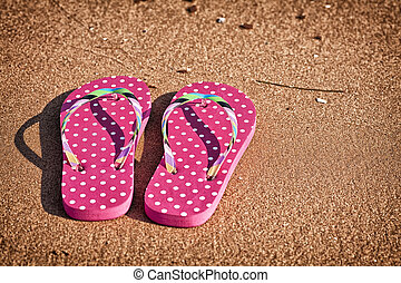Flip Flops - Pink polka dotted flip flops on the beach