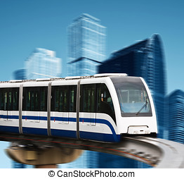 high speed monorail on a background of skyscrapers