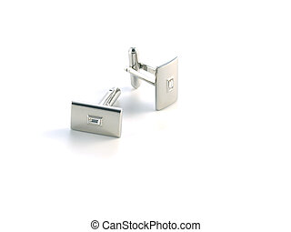 cuff link - silver cuff link isolated on white background