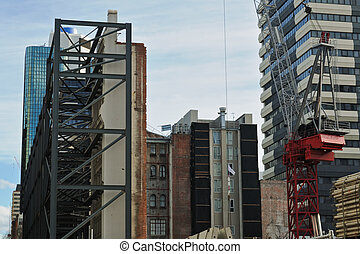 Facade support and crane - Construction site with old...